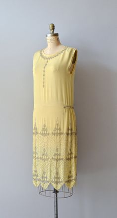 vintage 1920s beaded silk flapper dress - Vintage 1920s warm yellow silk crepe dress w/ silvery-gray beading along the collar, down the bodice, on small tabs on each side of the waist & heavily on the skirt in a geometric pattern;  no closures, slips on easily over the head - by DearGoldenVintage on etsy $745