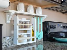 A backsplash shelf is a great way to organize your frequently used kitchen gadgets, while keeping your kitchen countertop clear from clutter. Kitchen Cabinetry, Kitchen Backsplash, Kitchen Countertops, Kitchen Shelves, Diy Kitchen Storage, Kitchen Organization, Kitchen Decor, Kitchen Ideas, Organized Kitchen