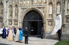 Queen Elizabeth II unveils a Statue of herself and the Duke of Edinburgh she unveiled to celebrate the Queen's Diamond Jubilee as she visits Canterbury Cathedral on March 26, 2015 in Canterbury, England.