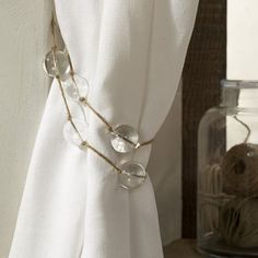 Tie back curtains with jewelry you don't wear anymore
