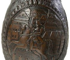 Detail of an old coconut carving