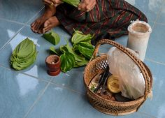 Granny with her Betel Basket and betel chew kit including betel leaf and mortar and pestle. Chewing Betel Nut in Rural Thailand Isaan with gummy old grannies. Ingredients of betel chewing include Areca nut, betel leaf and sandstone paste. Traditions and Culture in rural Thailand (Isaan) by http://potatoinrice.com/