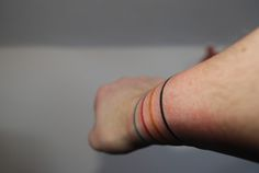 i love the idea of getting a simple line tattoo. i think it would look like a delicate bracelet.