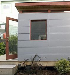 Large scale siding in light or dark grey to cover up the concrete base of our house