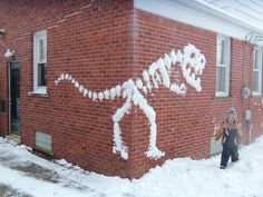 Did your town get walloped with snow this week? Perhaps it's still coming down. Sure you and your kids could get out there with your carrot and scarf for a traditional snowman - or - you could try something really rad like these inspired pieces of snow art.