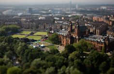 A beautiful view of Glasgow on the first day of action in the 2014 Commonwealth Games. The first event of the games is lawn bowls, the venue of which is Kelvingrove Park, above left