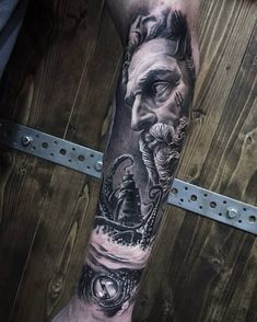 Awesome black and grey tattoo of Poseidon motive done by tattoo artist Ash Lews