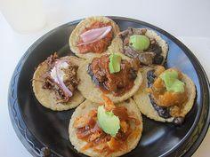 Guisados sampler taco plate chicken mole with sesame seeds, bistec with chile rojo, tinga de pollo and chicharon