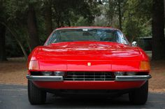 "1971 Ferrari 365 GTB/4 Daytona  Chassis No. 14083     Specs: 352 hp, 4,390 cc DOHC V12 engine, 6 Weber carburetors, five-speed manual transaxle, independent front and rear suspension by coil springs and wishbones, four-wheel hydraulic disc brakes. Wheelbase: 94.5""  History: The ultimate expression of the front-engine V12 Ferrari, the 365 GTB/4 is instantly recognizable. Illustrating Enzo's dictum that ""the horse does not push the cart, it pulls,"" the Daytona's exaggerated hood practically…"