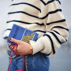 We love the cheekiness of this book clutch. Complete the arty intellectual look with a pair of specs.