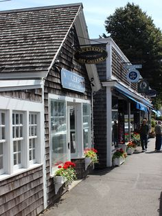 Shops and boutiques line Main Street in the Historic Business District in Chatham, Massachusetts.  Chatham is located on the southeastern corner of Cape Cod, sometimes referred to as the Elbow of the Cape.