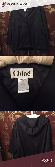 Chloe oversized swing Coat Stylish Chloe coat with hood. This is meant to be oversized. Would be great for a medium-large. It was always just a little too oversized for me. It's absolutely stunning and in perfect condition. You can't get Chloe anywhere, even at a thrift shop for under $500... this made in France piece is 62%wool, 35%polyamide, 2% elastane. This coat would be great over a cocktail dress or great casual! That's why I bought it originally. Was purchased at Intermix in the West…