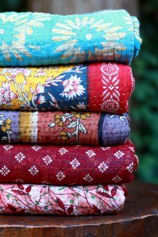 Blankets and quilts made of saris by women in India. And in the name of worthy cause. #India