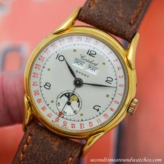 Look at this timepiece! A era Cortebert Triple Date Moonphase Reference This example comes equipped with a two-tone, grey & silver dial with black-colored, Arabic numerals and yellow gold-colored dot markers. Cool Watches, Men's Watches, Pocket Watches, Moonphase Watch, Just For Men, Vintage Watches For Men, Watch Companies, Moon Phases, Luxury Watches