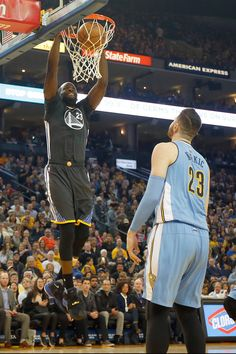 . Golden State Warriors\' Draymond Green (23) dunks against Denver Nuggets\' Jusuf Nurkic (23) in the first half of an NBA game at Oracle Arena in Oakland, Calif., on Saturday, Jan. 2, 2016. (Ray Chavez/Bay Area News Group)