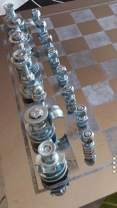 Bolts and nuts chess set and inox steel homemade corroded chessboard, pipes and magnets' support. No glue. No paint. No metal fusion.