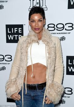 Hot mama: The model looked fantastic in a pair of strappy heels and distressed jeans Famous Black People, Nicole Murphy, Black Strappy Heels, 50 And Fabulous, Model Look, Beautiful Black Women, Sexy Hot Girls, Woman Crush, Female Models