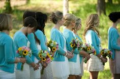 Let your bridesmaids pick their own dresses (similar color and length) but tie it all together with matching cardigans.  --Photo by Aimee Howell Photography