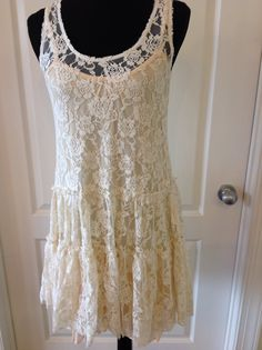 Lace dress over a slip dress at sister kates