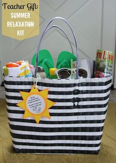 "Summer Relaxation Kit for teachers. Includes beach towel, sunglasses, flip flops, 2 magazines, and a grown up sippy cup. Sunshine tag says ""All year you worked hard to make learning fun, So now it's your turn to relax in the sun!"""