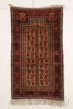 Baluch Prayer Rug, Northeast Persia, late 19th century, (some black oxidation), 5 ft. x 2 ft. 10 in. Estimate $1,000-1,200sold for:$1,896