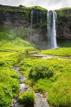 Iceland Seljalandsfoss waterfall in summer, beautiful landscape with a little river and fresh green grass. Click on the link or the image to buy a poster, fine art print or canvas print: http://matthias-hauser.pixels.com/featured/iceland-seljalandsfoss-waterfall-matthias-hauser.html 30 days money back guarantee. Matthias Hauser hauserfoto.com - Art for your Home Decor and Interior Design needs.