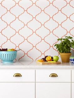 Use color in unexpected ways. Normally, you choose a trendy tile color—not a wild shade of grout. But this backsplash is totally twisted. A peachy pink tone surrounds the fun Moroccan shape.