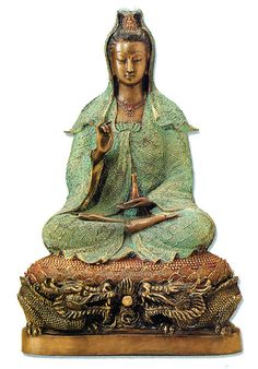 Well, another Quan Yin. Who can see her enough? And isn't that a dragon throne sort of meditation cushion?