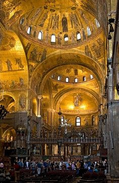 ST. MARK'S Basilica, Venice. Interior view with golden mosaics looking northeast side. Spectacular gilded mosaics cover a total area of about 8,000 square meters on the vaults and cupolas. Dating mostly from the 12th century, the interior mosaics proclaim the message of Christian salvation through events from the New Testament.