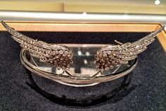 Made in England around 1900, this ethereal tiara features bird wings that can be detached and worn as brooches.