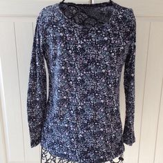 Black patterned pullover top with long sleeves Lightweight pullover top. Pattern design. Gently worn. Daisy Fuentes Tops