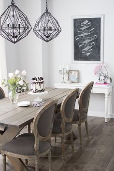 Blogger home tour: Inside a bright modern Parisian inspired dining room with a diy farmhouse table.