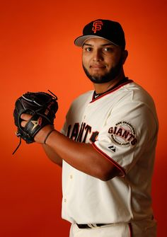 Pitcher Yusmeiro Petit #52 of the San Francisco Giants poses for a portrait during spring training photo day at Scottsdale Stadium on February 27, 2015 in Scottsdale, Arizona. (February 26, 2015 - Source: Christian Petersen/Getty Images North America)