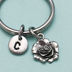 Rose keychain, rose charm, flower keychain, personalized keychain, initial keychain, initial charm, customized, monogram. Rose charm keychain with hand stamped initial *Initial charm is antique silver pewter 9mm *Rose charm is antique silver pewter *Your purchase will arrive packaged in a cute gift box and I will include a message by request.
