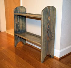 This listing features a handmade wooden shoe rack. This handmade wooden shoe rack is approximately 2 ft X 2 ft X 8 in and weighs approximately 12 lbs. The wooden shoe rack pictured is made with pine lumber, stained with weathered grey stain, and finished with furniture varnish.