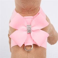 This puppy pink dog harness features an oversized bow accented with a center filled with rows of sparkling Swarovski crystals. Like all doggie designs by Susan Lanci, this soft dog harness is made from genuine upholstery grade Ultasuede® fabric