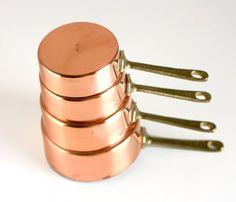 copper measuring cups.