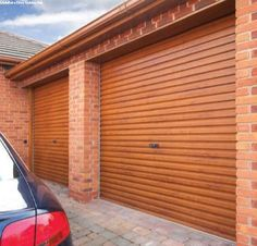 Golden Oak Gliderol Roller Garage Doors. Blend modern door engineering with traditional finishes to add & Anthracite Roller Garage Doors installed by Swan Gates Yorkshire ...