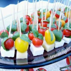Appetizer with chery tomatoes, basil and cheese(make with goat cheese)