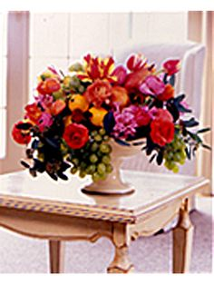 Springtime Flowers & Fruits in Footed Dish: • Footed dish • Floral oasis (available at craft or floral supply stores)   • 3-in. floral sticks (available at craft or floral supply stores) • Assorted fruits: nectarines, peaches, pears, lemons & grapes • Pink ranunculus, pansies, tulips, pink hyacinth (about 2 doz.  stems) • Eucalyptus or greens for filling   *Directions: Soak floral oasis in a bowl of water overnight. Place floral oasis in  footed dish. [cont]