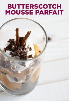 Cut the brownie into chunks, then layer in a cup or bowl, alternating butterscotch and whipped topping. Crack the pretzels on top and serve.