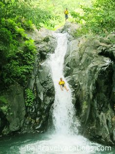 Sliding at Kroya Waterfall, Sambangan 7 great waterfalls Singaraja Lovina tour is special North Bali  sightseeing to get adventure to Sambangan trekking  for 2 hours and enjoy the atmosphere of Buleleng Regency.