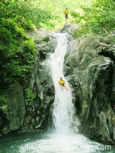 Sliding at Kroya Waterfall, Sambangan 7 great waterfalls Singaraja Lovina tour is special North Bali  sightseeing to get adventure to Sambangan trekking  for 2 hours and enjoy the atmosphere of Buleleng Regency.