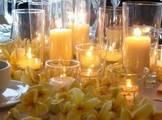 Candles and yellow flowers centerpieces