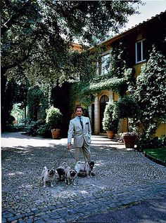 Valentino's home in Rome by Renzo Mongiardino with his pugs