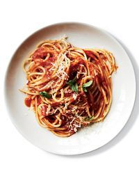 Sauce-Simmered Spaghetti al Pomodoro / Top Chef finalist Sarah Grueneberg cooks parboiled spaghetti right in the tomato sauce so it becomes infused with flavor. / Food & Wine
