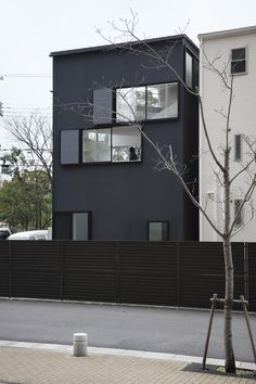 Spiral House by Alphaville Architects is painted black, with a bright white interior.