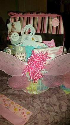 Baby shower basket with diaper bag, onesies, outfits, socks, essentials, album, blanket #diy #giftbasket #babyshowerbasket #babyshowerforgirls