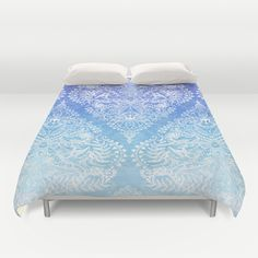 Out of the Blue - White Lace Doodle in Ombre Aqua and Cobalt duvet covers by Micklyn
