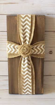 This wood sign is made from plywood that is first sanded, primed and hand painted with acrylic paint. It is painted with natural tones such as yellow, orange and browns to resemble natural wood and then wrapped with burlap and white chevron ribbon creating a cross and completed with a burlap flower bud. This inspirational fabric Cross Sign easy hangs by a saw tooth hanger that is attached to the back of the board or can be propped on a bookshelf or table to add to any rooms décor. They also…